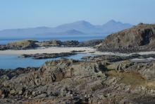 Bay MacNeil with The Small Isles in the background