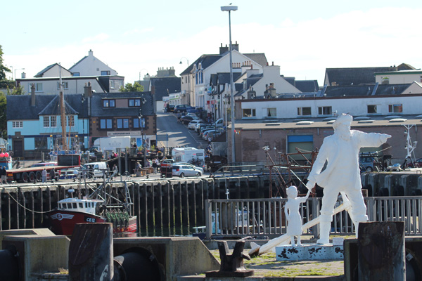 Fisherman and Child Sculpture by Mark Rogers on Mallaig Harbour